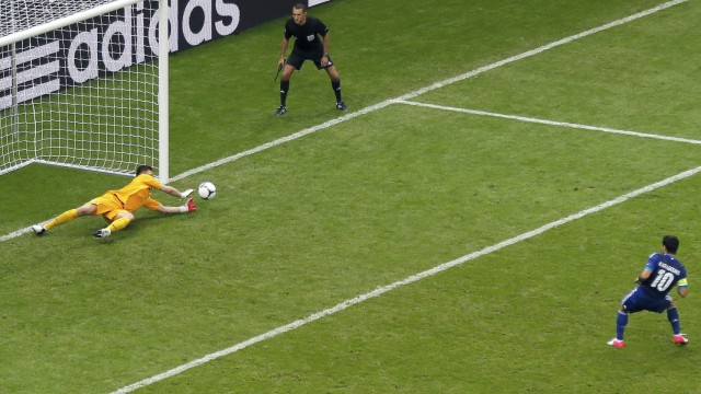 Poland's goalkeeper Tyton saves a penalty kick of Greece's Karagounis during their Group A Euro 2012 soccer match at the National stadium in Warsaw