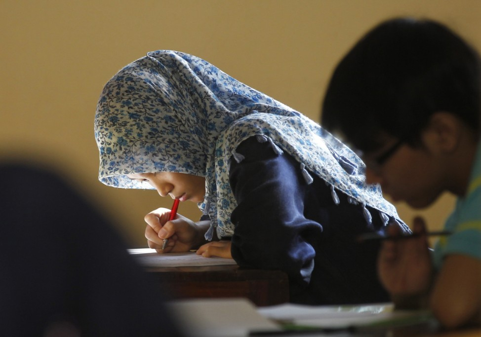 Students who have recently graduated from senior high school take part in a state university entrance exam in Jakarta