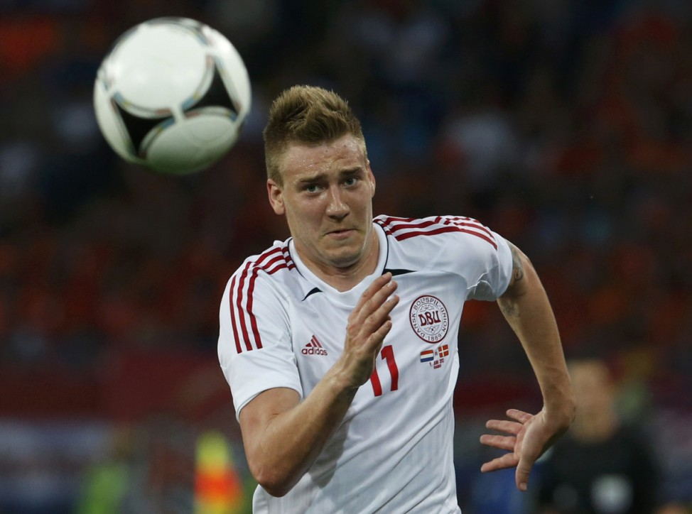 Denmark's Bendtner controls the ball during their Group B Euro 2012 soccer match against the Netherlands at the Metalist stadium in Kharkiv
