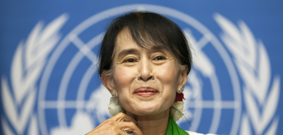 Myanmar's pro-democracy leader Suu Kyi attends a news conference after addressing the 101st session of the International Labour Conference of the International Labour Organisation at the United Nations European headquarters in Geneva