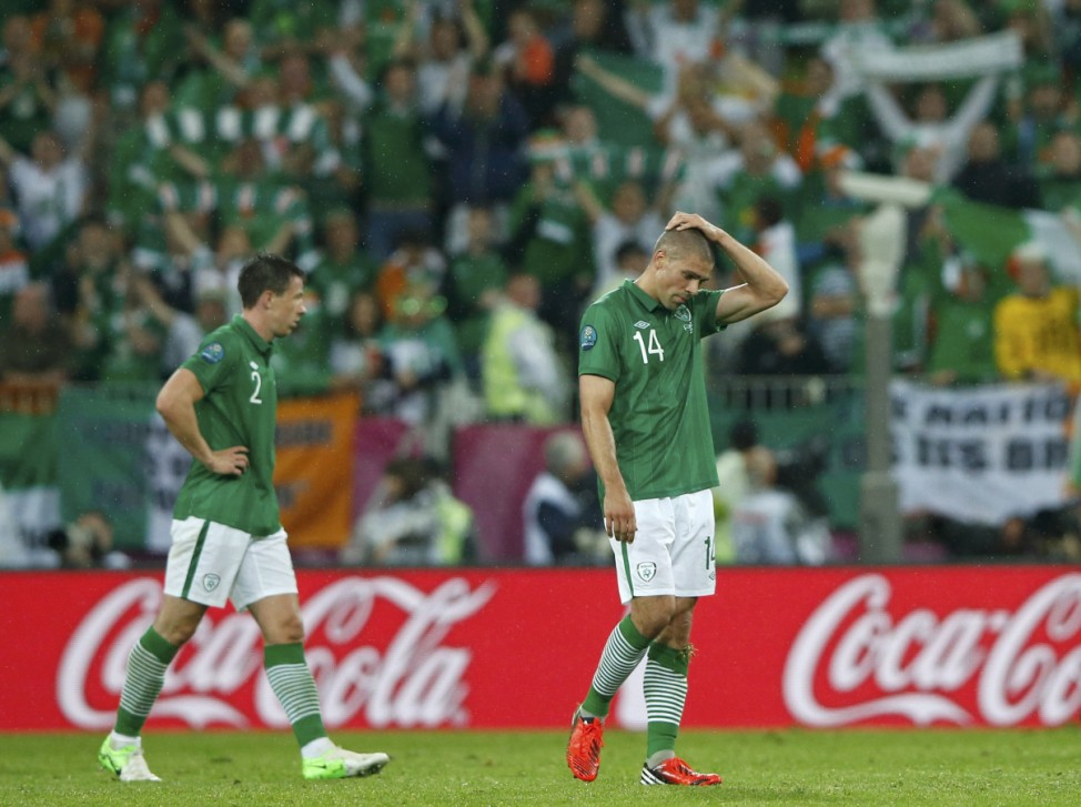 Ireland's Walters and St Ledger react as they leave a pitch after their lost Group C Euro 2012 soccer match against Spain at the PGE Arena in Gdansk
