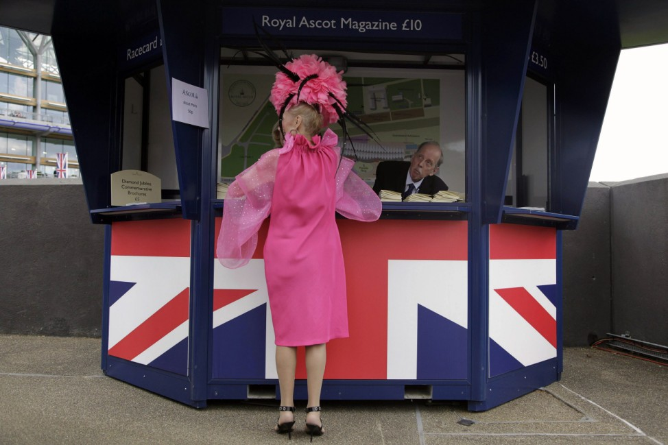 Racegoer Claridge purchases a race magazine on the second day of racing at the Royal Ascot, southwest of London