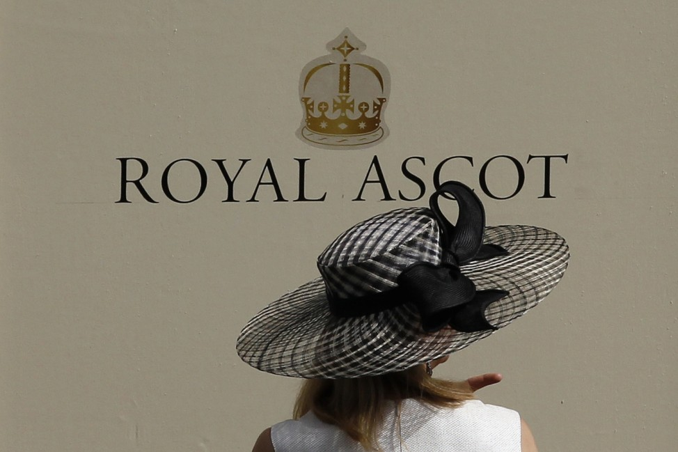 A racegoer arrives on the second day of racing at the Royal Ascot, southwest of London