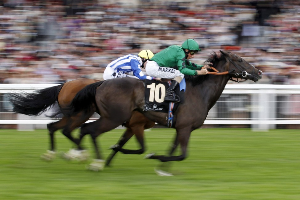 Buick on Joviality wins The Windsor Forest Stakes ahead of Queally on Chachamaidee during the second day of racing at Royal Ascot in southern England