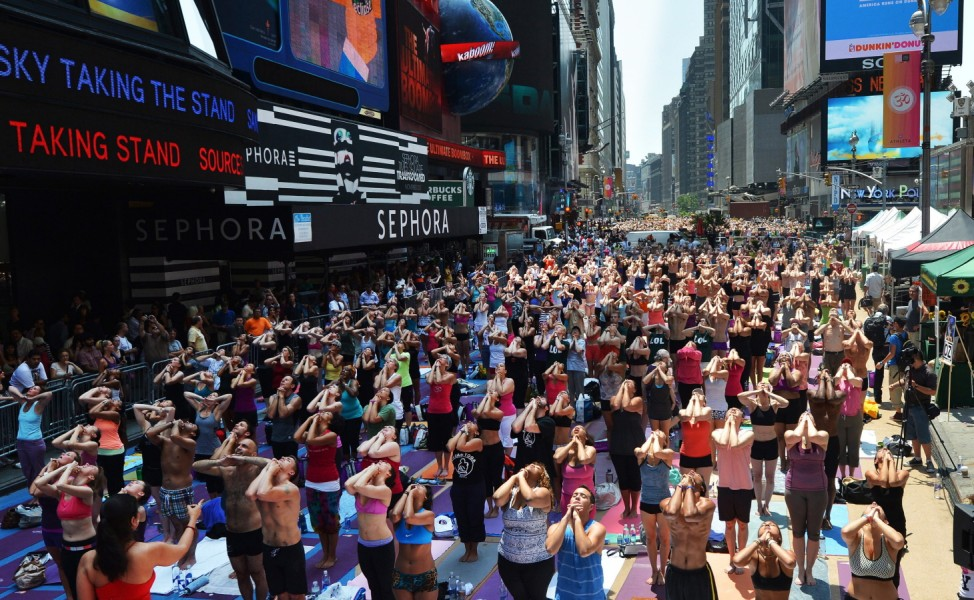 People do yoga in Times Square to celebrate summer solstice