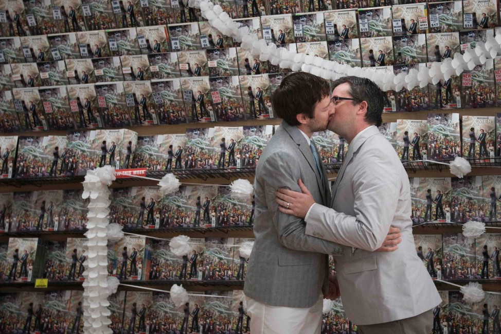 Welker and Everhart kiss after exchanging vows during their wedding ceremony at a comic book retail shop in Manhattan, New York