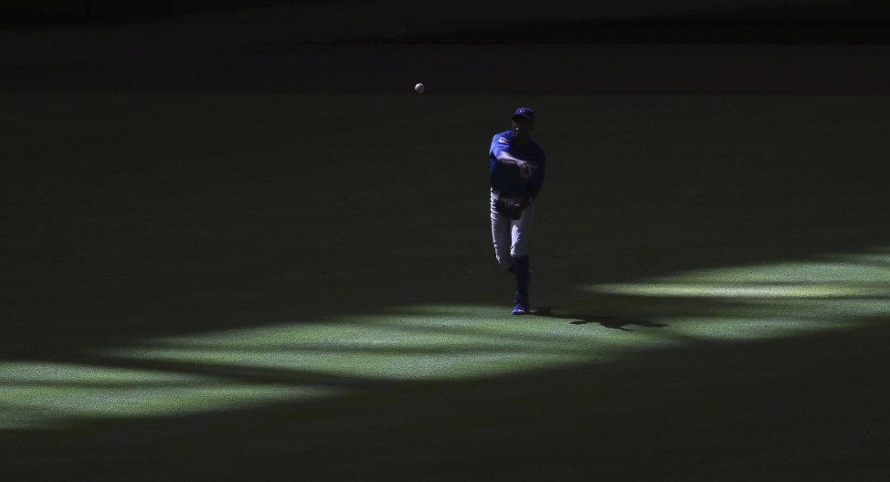 Chicago Cubs' left fielder Soriano makes a throw into third base in the 8th inning as shadows make their way across left field, during their MLB National League baseball game in Phoenix