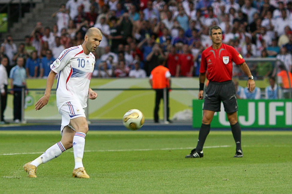 FFrance's Zinedine Zidane scores a penalty for his team's first goal against Italy in Berlin