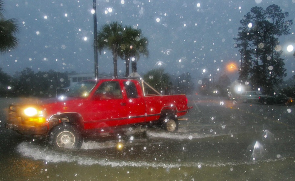 As a heavy rain squall hits, a driver leaves a wake as he turns on Riverside Drive in St. Marks
