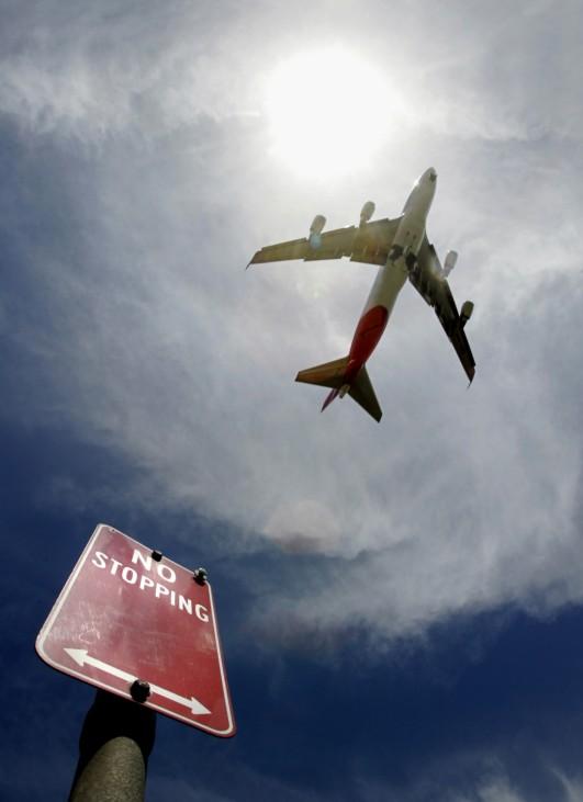 Qantas passenger plane takes off from Sydney International Airport