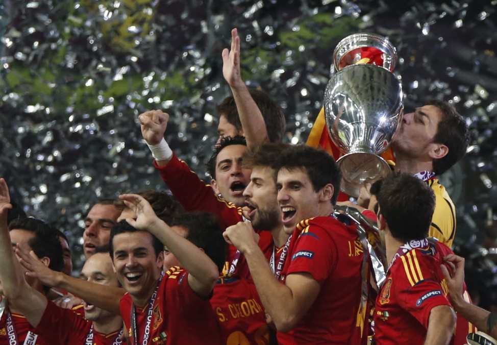 Spain's Casillas kisses the trophy after defeating Italy to win the Euro 2012 final soccer match at the Olympic stadium in Kiev