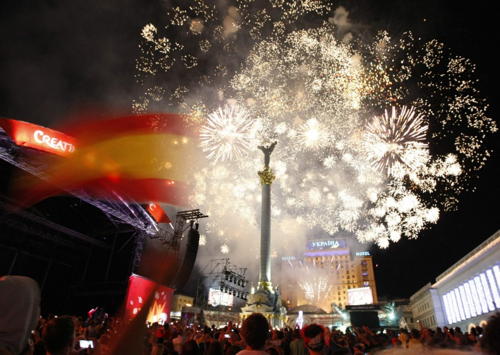 Fireworks explode in the sky over Independence Square in central Kiev, after the Euro 2012 final soccer match between Spain and Italy