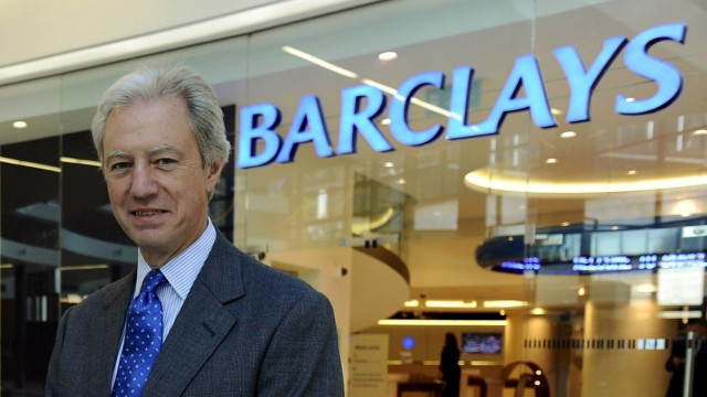 File photo of Barclays Plc Chairman Marcus Agius posing at a bank branch near their Canary Wharf headquarters in London