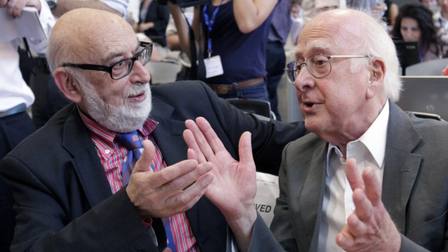 British physicist Peter Higgs talks with Belgium physicist Francois Englert before a news conference update in Meyrin