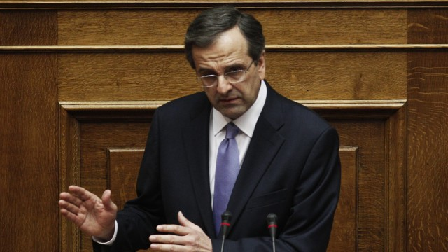 Greek PM Antonis Samaras reads the policy statement of the new go