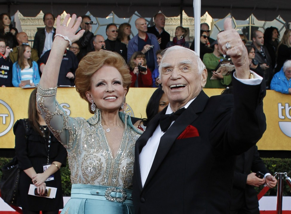 File photo of actor Ernest Borgnine waving with his wife Tova while arriving at the 17th annual Screen Actors Guild Awards in Los Angeles