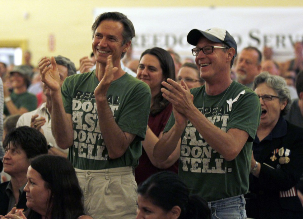A man and his partner clap as they celebrate with members of San Diego's gay and lesbian community the expiration of U.S. military policy 'Don't Ask Don't Tell' in San Diego