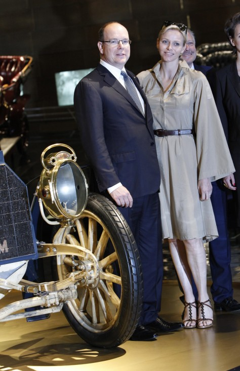 Monaco's Prince Albert II and Princess Charlene pose next to a 1902 Mercedes Simplex at the Mercedes Benz Museum in Stuttgart