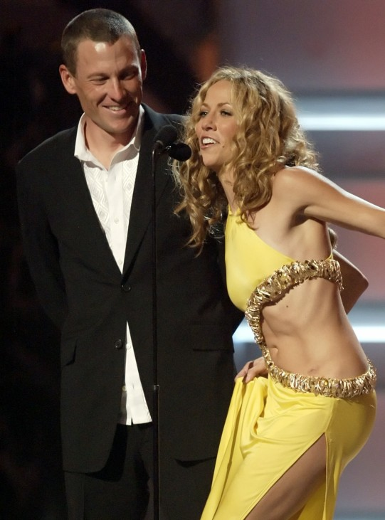 Lance Armstrong and Sheryl Crow present record of the year award at Grammy Awards