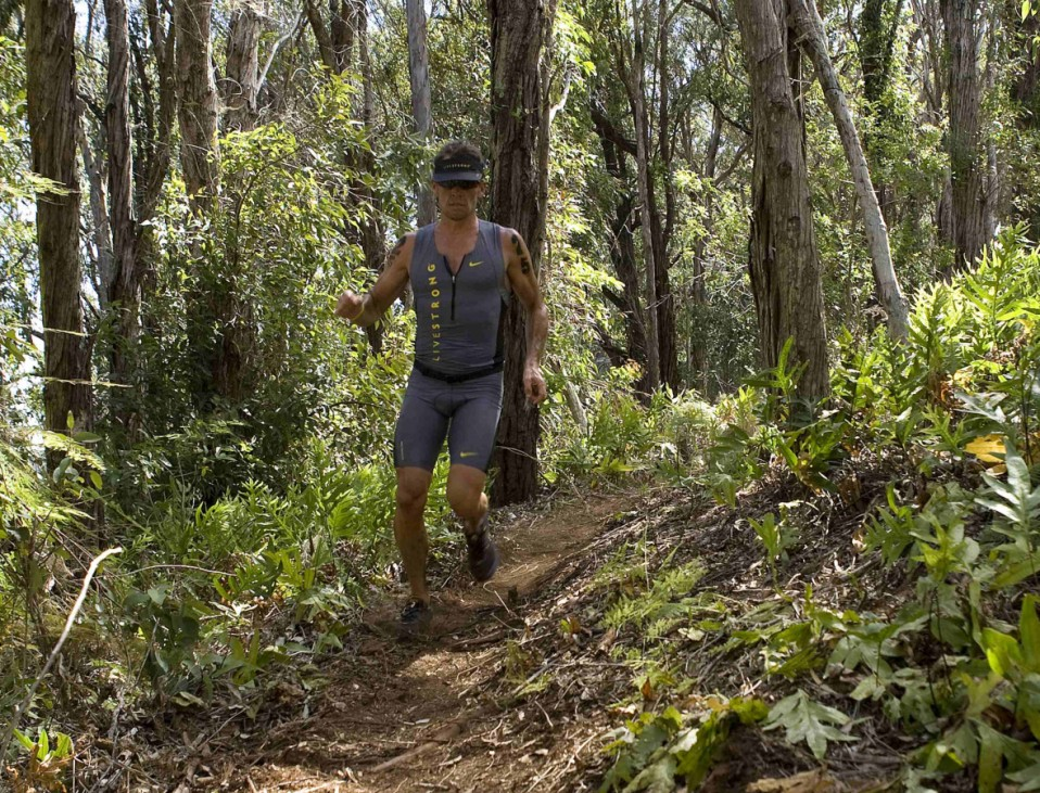 Lance Armstrong runs on the trail during the running portion of the Xterra World Championship triathlon in Kapalua, Hawaii