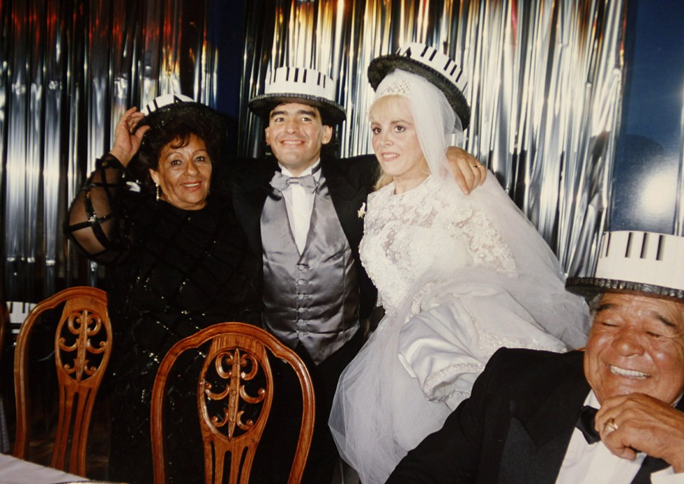 File photo of Argentine soccer great Diego Maradona posing with his mother, wife and father during his wedding party in Buenos Aires