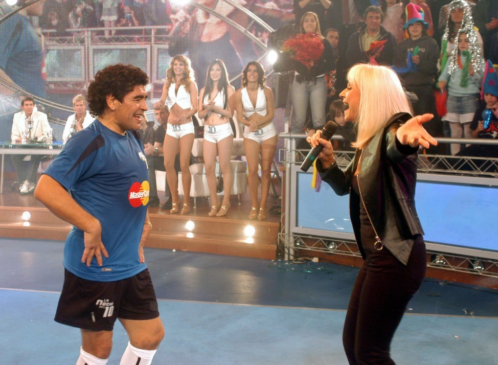 Former Argentine soccer star Maradona dances with Italian singer and TV star Carra in Buenos Aires