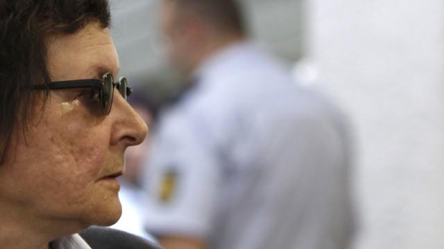 Defendant Becker, former member of 'anti-imperialist' RAF,  arrives for judgment in courtroom in Stuttgart