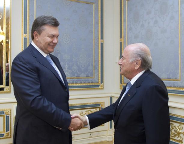Ukraine's President Viktor Yanukovich shakes hands with FIFA President Sepp Blatter during their meeting in Kiev