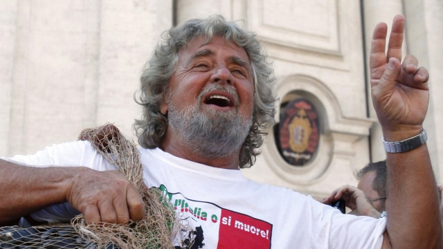 File picture shows comic and political activist Beppe Grillo gesturing before dumping rotten mussel shells in front of parliament in Rome