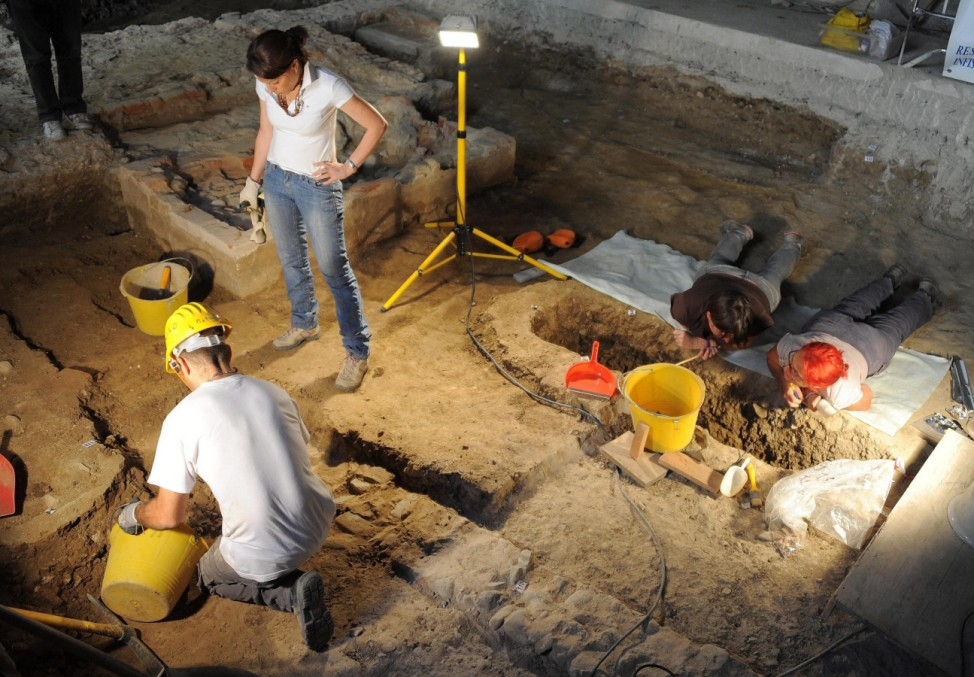 Researchers resume works at the base of an altar found in the for