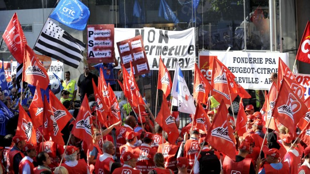 PSA workers demonstrate by the headquarters in Paris