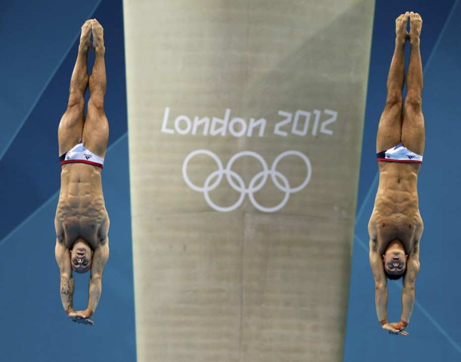 Britain's Peter Waterfield and Tom Daley perform a dive in the men's synchronised 10m platform final during the London 2012 Olympic Games