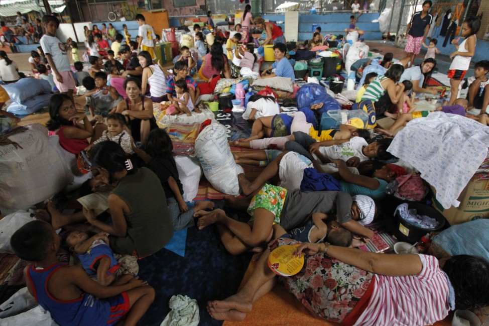Typhoon victims rest at an evacuation center in Manila
