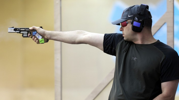 Germany's Ralf Schumann competes in the men's shooting 25m rapid fire pistol qualification round at the London 2012 Olympic Games at the Royal Artillery Barracks