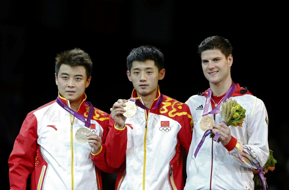 Medallists celebrate during the medal ceremony of the men's singles table tennis tournament at the ExCel venue during the London 2012 Olympics