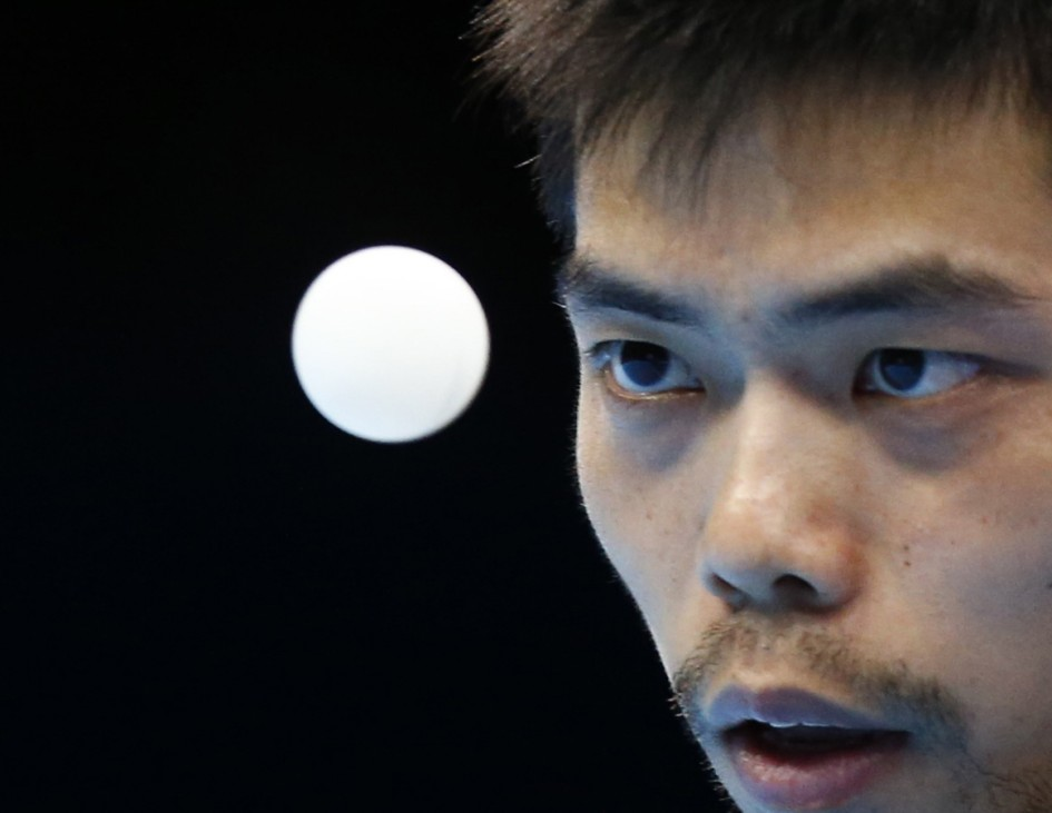 Taiwan's Chuang Chih-yuan serves to China's Wang Hao in their men's singles semifinals table tennis match at the ExCel venue during the London 2012 Olympic Games