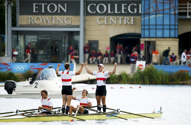 Athletes from team Germany celebrate after winning the Men's Quadruple Sculls Final event during the London 2012 Olympic Games at Eton Dorney