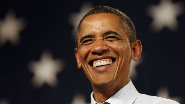 U.S. President Obama smiles at a campaign event at Rollins College in Orlando