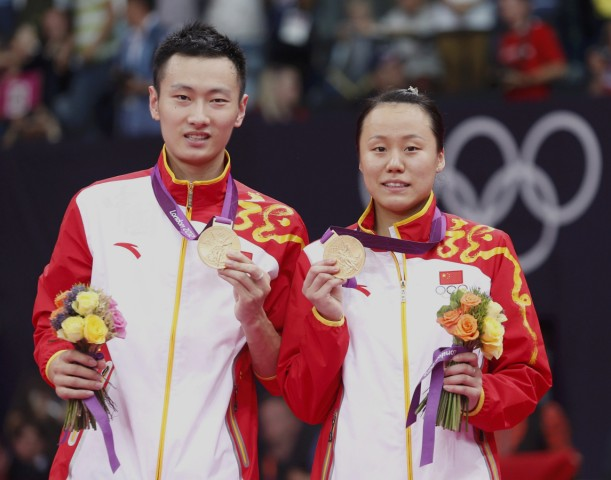 Gold medalists China's Zhang Nan and Zhao Yunlei pose for media during the victory ceremony for badminton mixed doubles event at London 2012 Olympic Games at Wembley Arena
