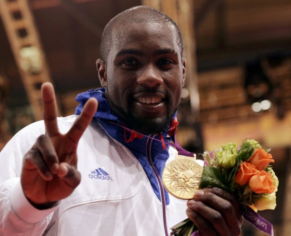 Gold medallist France's Teddy Riner poses at the victory ceremony for the men's +100kg judo event at the London 2012 Olympic Games