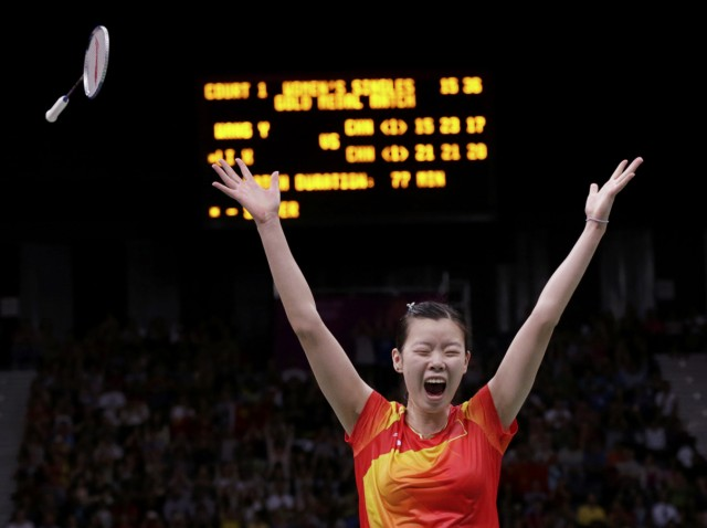 China's Li Xuerui celebrates winning her women's singles badminton gold medal match against compatriot Wang Yihan at the London 2012 Olympic Games at the Wembley Arena