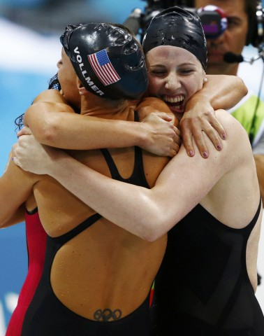 Dana Vollmer (L), Missy Franklin (R) and Rebecca Soni embrace after a world record gold medal win in the women's 4x100m medley relay final with team mate Allison Schmitt during the London 2012 Olympic Games at the Aquatics Centre