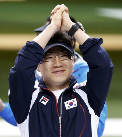 South Korea's Jin Jongoh celebrates after winning gold during the men's 50m pistol finals at the Royal Artillery Barracks during the London 2012 Olympic Games