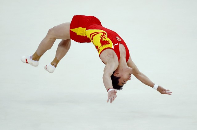 Zou Kai of China competes in the men's gymnastics floor exercise final in the North Greenwich Arena during the London 2012 Olympic Games