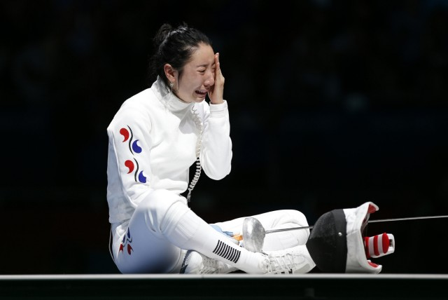 South Korea's Shin reacts after being defeated by Germany's Heidemann during their women's epee individual semifinal fencing competition at the ExCel venue at the London 2012 Olympic Games