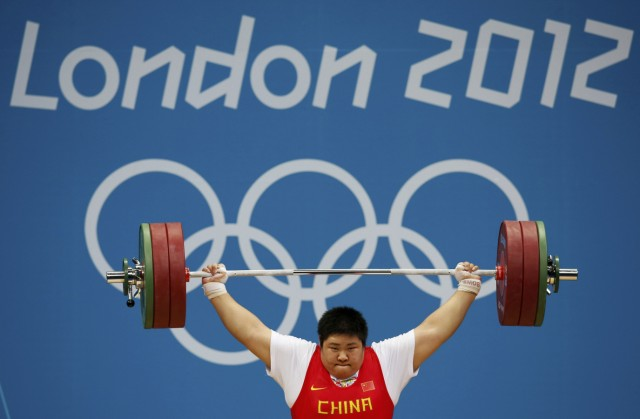 China's Zhou Lulu competes in the women's +75kg group A snatch weightlifting competition at the ExCel venue during the London 2012 Olympic Games