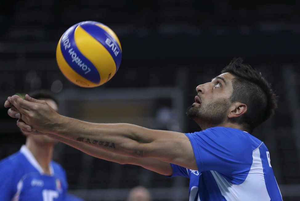 Italy's Dante Boninfante returns ball during team practice for men's volleyball competition at London 2012 Olympic Games in London