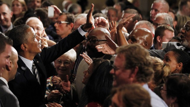 U.S. President Barack Obama greets members of the audience after delivering remarks at an election campaign fundraiser in Stamford