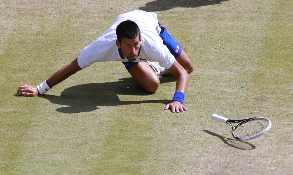 Djokovic falls during the men's singles tennis bronze medal match at the London 2012 Olympic Games