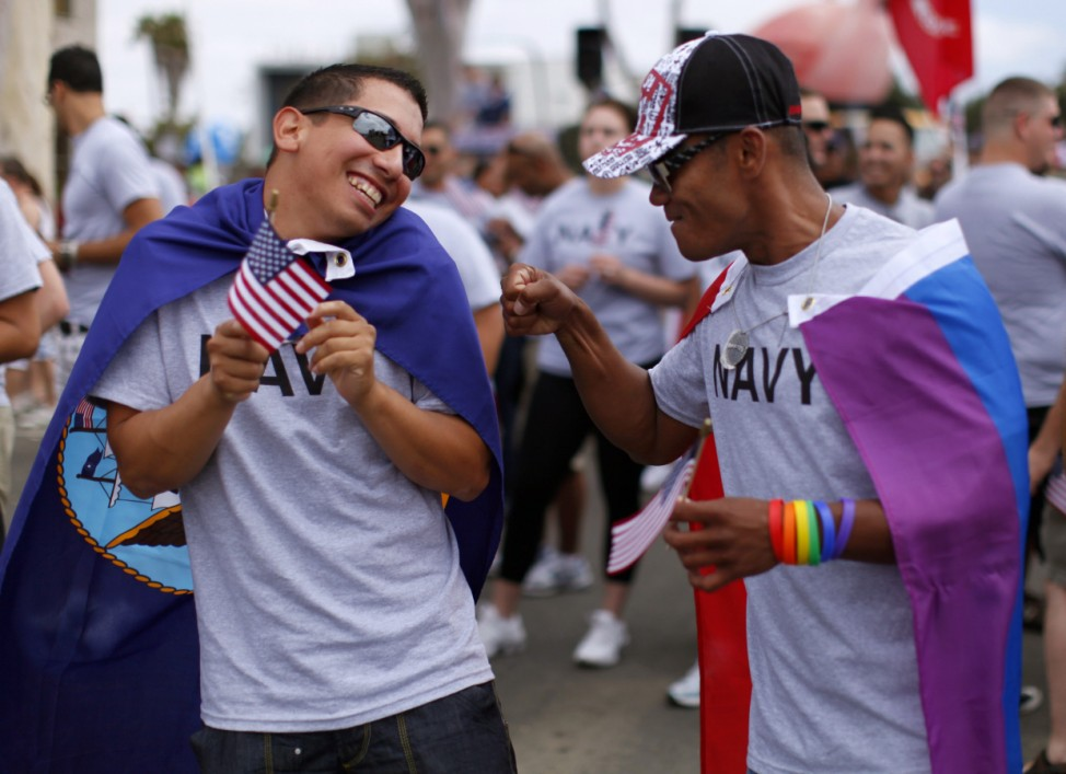 File photo of Avila, active duty gunners mate 2nd class U.S. Navy, receiving a punch in arm from former EN2 U.S. Navy's Cordero in San Diego